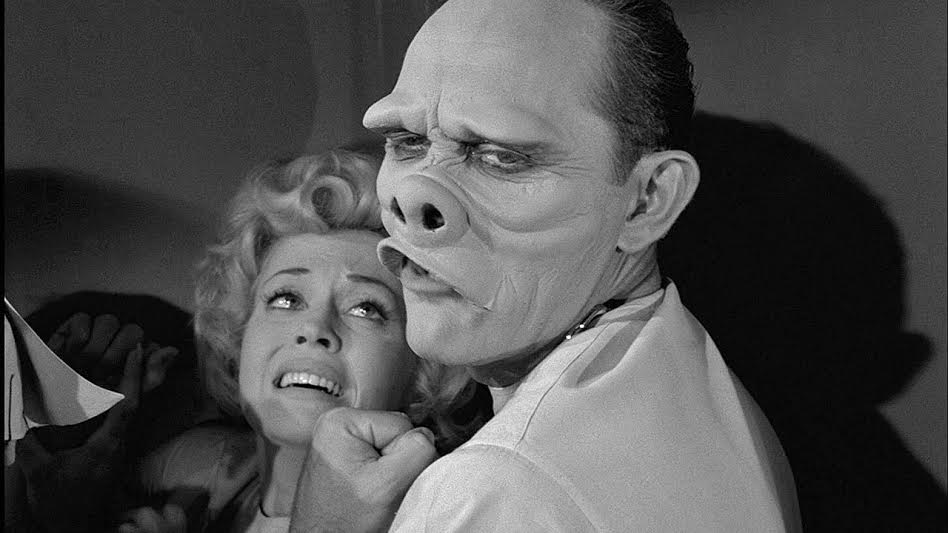 "Sort of like that episode of the Twilight Zone were a woman gets surgery to look ""normal"". However she looks like a regular human. At the end of the episode you find out that normal is a bunch of pig people."