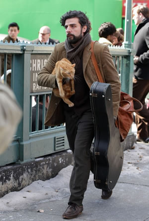 Oscar Isaac on set of Inside Llewyn Davis