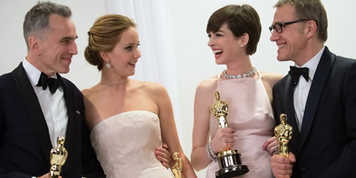 Daniel Day-Lewis, Jennifer Lawrence, Anne Hathaway and Christoph Waltz backstage at the 2013 Oscars