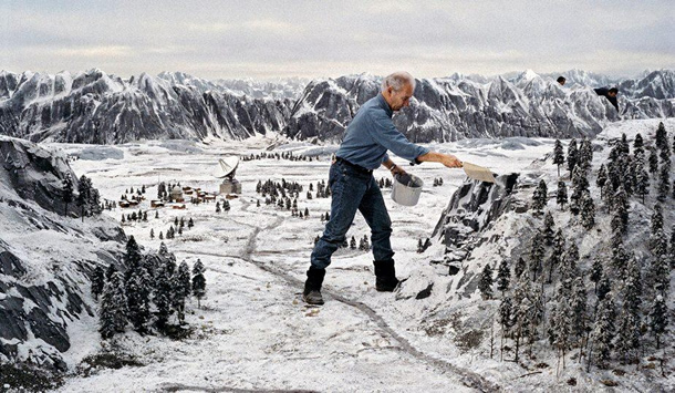 Derek Meddings creating the miniature satellite bunker set for GoldenEye