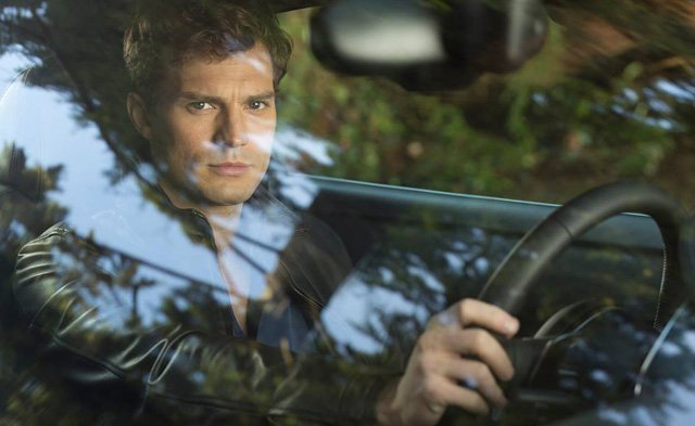 Jamie Dornan as Christian Grey in Fifty Shades of Grey