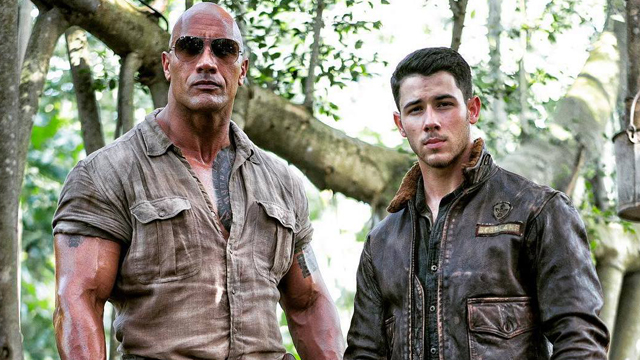 Nick Jonas and Dwayne Johnson are featured in costume on the Jumanji set