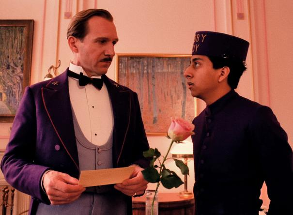 """Ralph Fiennes as """"M. Gustave"""" and Tony Revolori as """"Zero."""""""